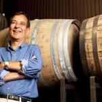 ** warning: for less than 1.75 col ** for Business - 18spirits - Boston Beer Co. founder Jim Koch in front of barrels of Utopia, one of the beers that will be distilled into whiskey. (Boston Beer Co.)